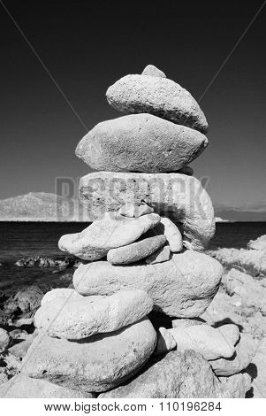 A tower of stones standing on Ftenagia beach at Emborio on the Greek island of Halki.