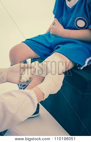 Young Sport Boy In Blue Uniform. Knee Joint Pain.