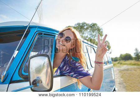 summer holidays, road trip, vacation, travel and people concept - smiling young hippie woman driving minivan car and showing peace gesture poster