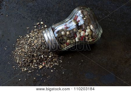 Pepper Mill With Crumbled Pepper Top View