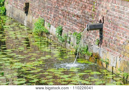 Rainwater Inlet In A  Castle Moat