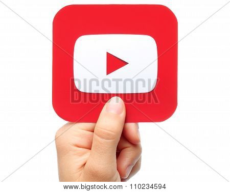 Hand holds YouTube icon
