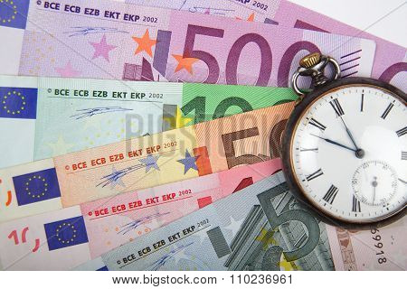 Time And Money Concept Image.   Euros With Vintage Watch.
