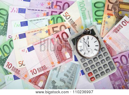 Time And Money Concept Image.  Close-up Of Euros, Vintage Watch And Calculator