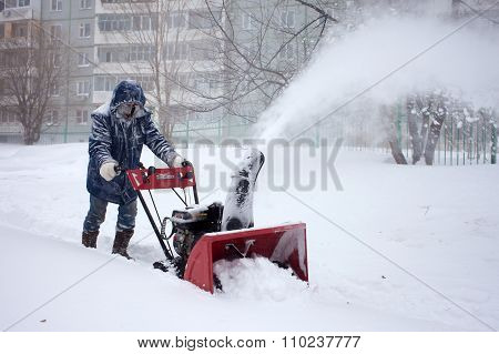 Khabarovsk, Russia - December 03, 2015: A Man Removing Snow With A Snowblower