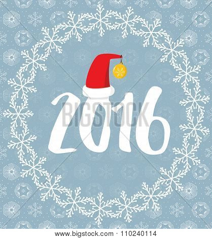 2016 covered with snowflakes on snowy background