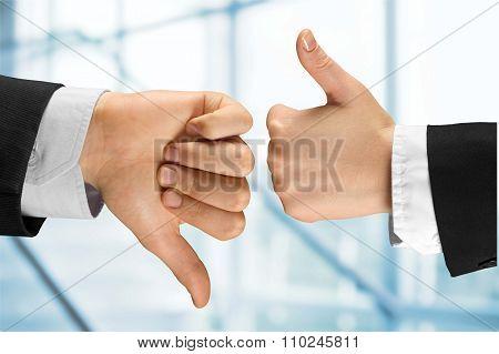 Human hands showing agree sign Versus disagree on background