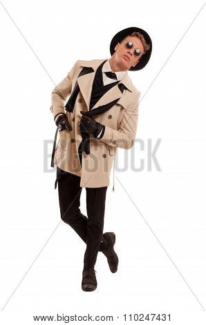Fashion Detective Undercover Posing On A White Background.