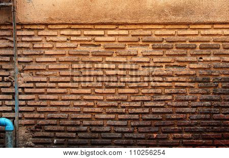 Old Soiled Brick Wall And Blue Gas Pipe