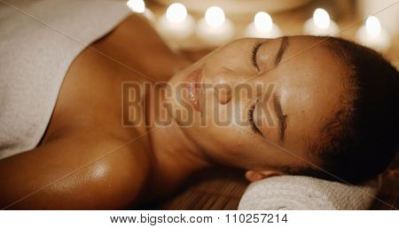 Young african-american beautiful woman relaxing at the spa