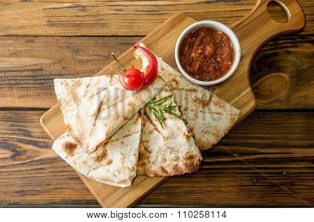 Tacos on wooden background with sauce