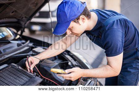 Mechanic troubleshooting a car engine