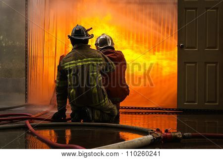 Firemen Fighting A Flames Of Burning Fire