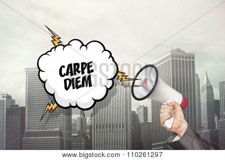 Carpe diem text on speech bubble and businessman hand holding megaphone