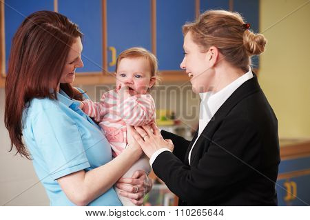 Working Mother Dropping Child At Nursery
