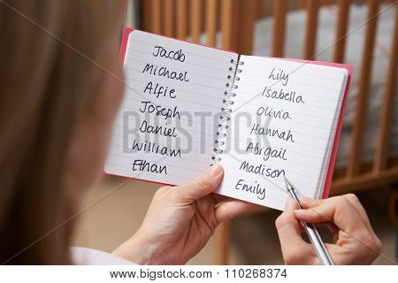 Woman Choosing Baby Names In Nursery