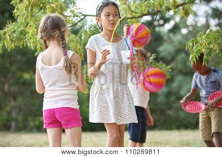 Group of kids with lampions at a birthday party