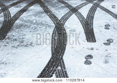 Car trace. Winter road.