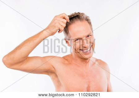Handsome Positive Shaved Aged Man Combing His Hair