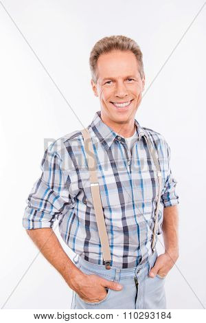 Confident Happy Aged Man In Suspenders Keeping Hands In Pockets