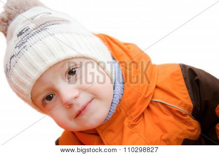 The Little Boy In Autumn Day Inclined The Head And Cunning Looks Askance. It Is Isolated On A White