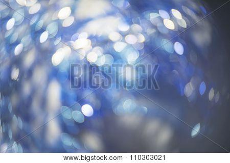 Defocused Lights on blue background. Blurred xmas garland.