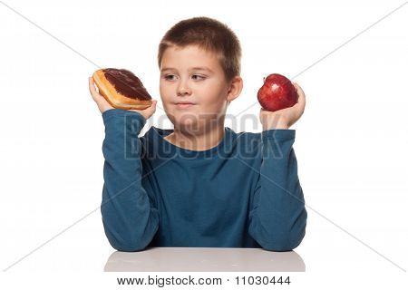 A Boy's Choice Of A Healthy Or Unhealthy Snack