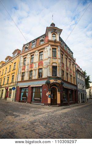 RIGA, LATVIA - CIRCA SEN, 2015: One of the streets in the medieval town of old Riga. Riga has long been a Hanseatic city, there are buildings of different styles from medieval to modern architecture.