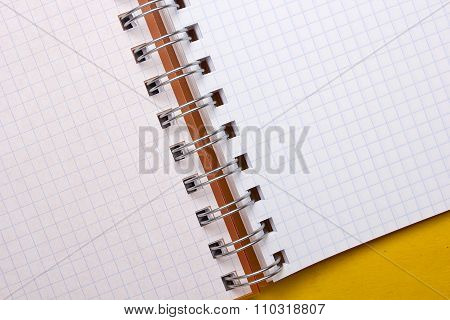 Opened notebook fastening spring. Background of notebook sheet in the box. poster