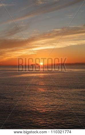 Orange sunset sky over Balboa Island