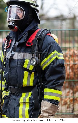 A fireman with breathing apparatus with mask