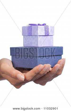 hand and stack of gift box over white background