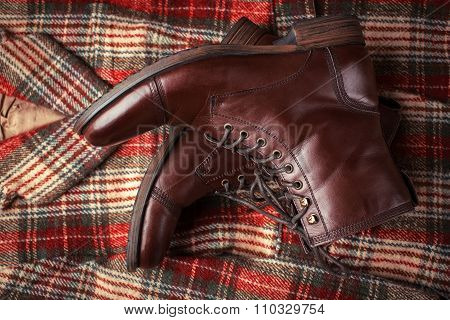 Leather Boots And A Checked Jacket