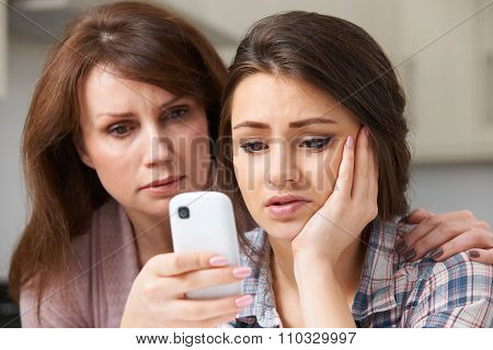 Mother Comforting Daughter Being Bullied By Text Message
