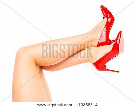 Sexy legs in Red high heels on white background.