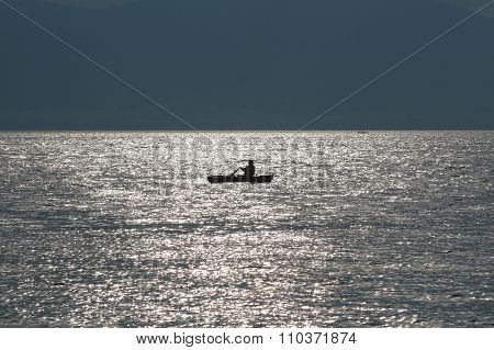 Silhouette of a fishing boat.
