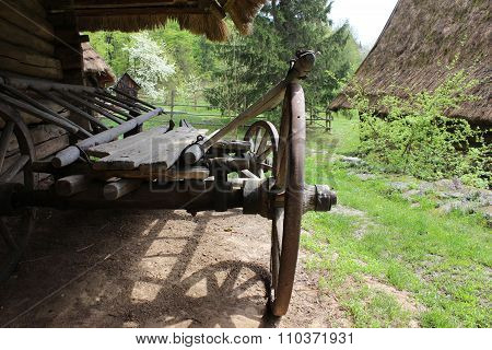 Old wooden wagon near the log house