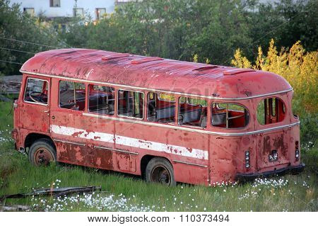 Abandoned Broken Red Bus At Chersky Town
