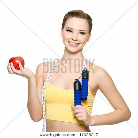 Happywoman With Red Apple And Skipping Rope