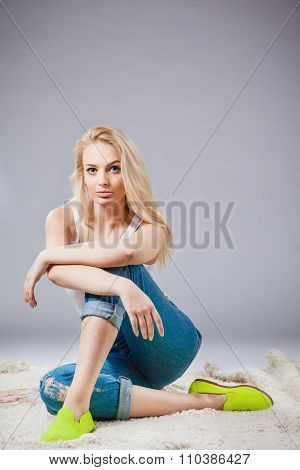 studio portrait of pretty young fashionable girl