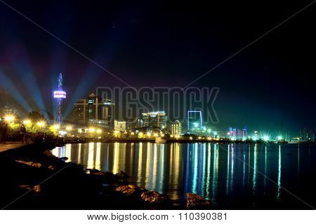 Baku Bulvar at night with light show and lots of people