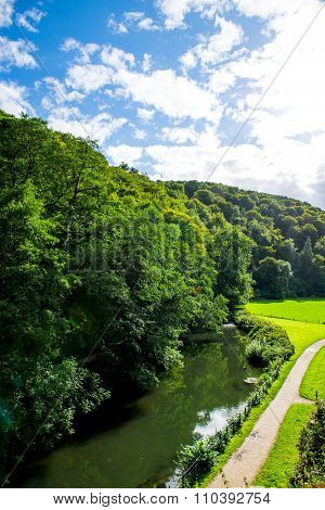 Green Meadows, River And Trees In Beautiful Ilam Hall  In Peak District National Park