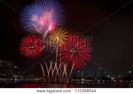 Colorful Fireworks Over Night Sky,red Fireworks Lines In Black Background