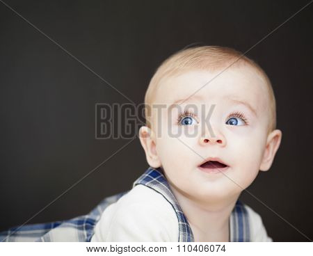 Portrait of adorable baby boy looking up