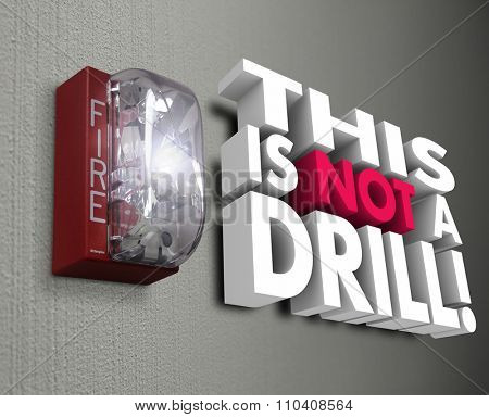 This is Not a Drill 3d words next to fire alarm to warn of an urgent emergency or crisis with evacuation or other safety procedure required