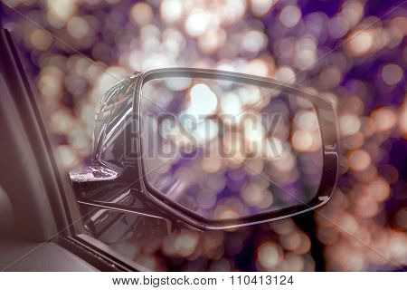 Vintage tone,soft focus, abstract car's wing mirror with blurred bokeh speed motion background and o