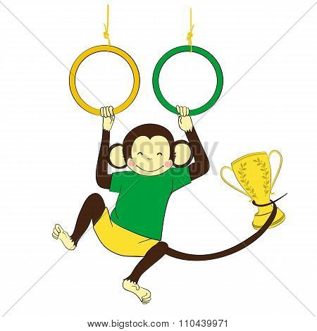 Victory. Monkey hanging on gymnastics rings and holding winning.