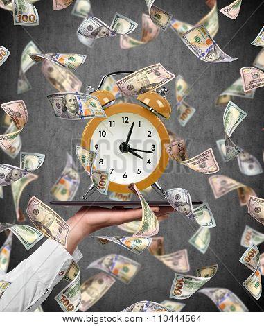 Flying Dollar Bills And Alarm Clock