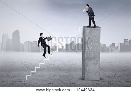 Company Leader Calling His Colleague