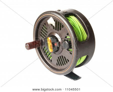 reel for a fishing tackle over white
